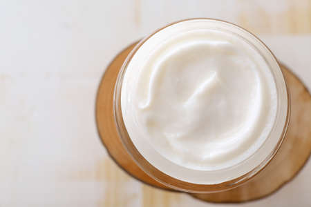 Jar of natural cream on light background Standard-Bild