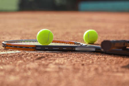 Racket and balls on tennis court