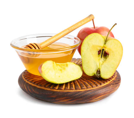 Bowl of fresh honey and apples on white background