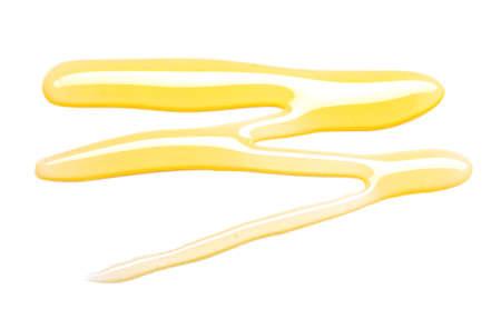 Spilled honey on white background
