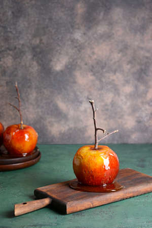 Tasty candy apple on color table