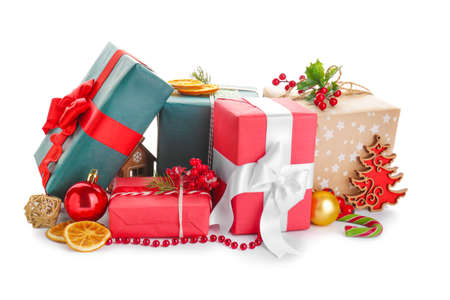 Beautiful Christmas gifts on white background Foto de archivo