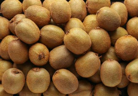 Many ripe kiwi as background