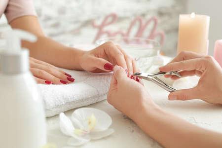 Woman getting professional manicure in beauty salon