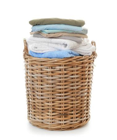 Basket with laundry on white background