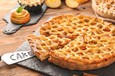 Tasty apple pie on table