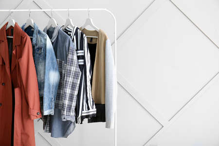 Rack with hanging clothes indoors