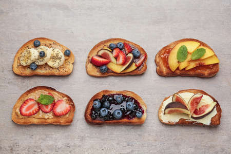 Different tasty sandwiches on gray background Stock Photo