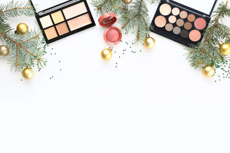 Christmas composition with decorative cosmetics on white background Standard-Bild