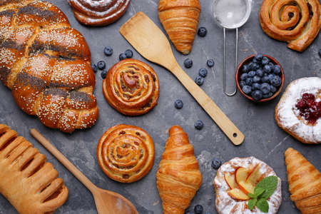 Assortment of sweet pastry on gray background