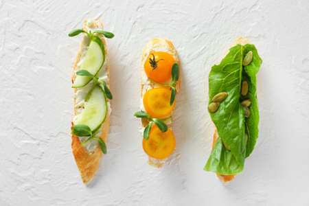 Different tasty sandwiches on white background