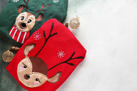 Christmas clothes on light background