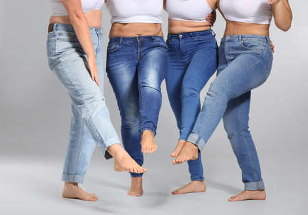 Group of body positive women on gray background Stock fotó