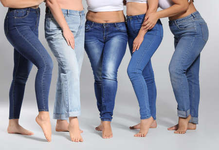 Group of body positive women on gray background