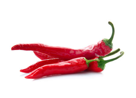 Red chili peppers on white background Imagens
