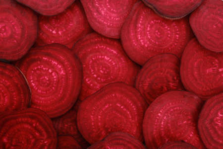Many pieces of fresh beet as background