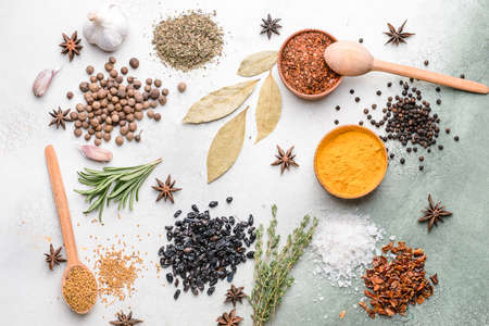 Different spices on light background