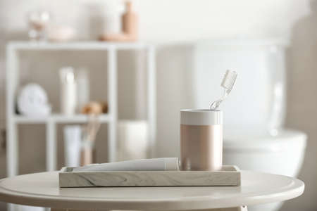 Toothbrush with paste on table in bathroom Imagens
