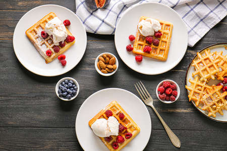 Composition with tasty waffles on table 写真素材