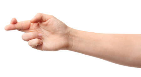 Hand of woman with crossed fingers on white background