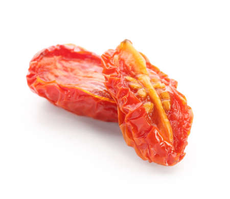 Dried tomatoes on white background