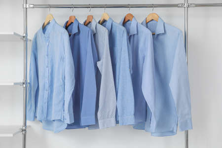 Rack with clothes in modern dry-cleaner's Stock Photo