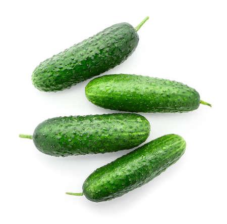 Fresh green cucumbers on white background
