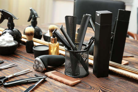Professional barber's tools on table in salon