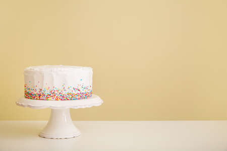 Tasty Birthday cake on table against color background Reklamní fotografie