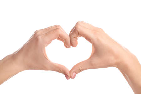 Young woman making heart with her hands against white background Foto de archivo