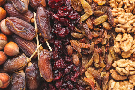 Different dried fruits and nuts as background