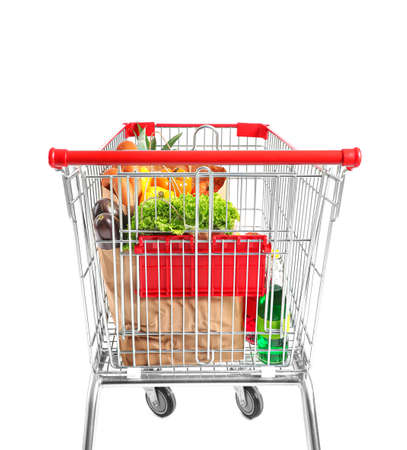 Shopping cart with products on white background