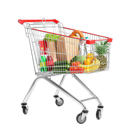 Shopping cart with products on white background Stockfoto