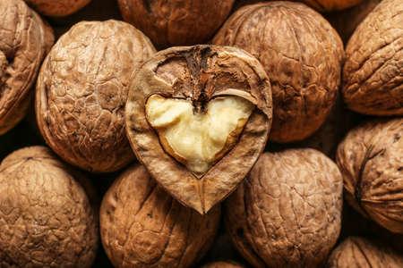 Many tasty walnuts as background