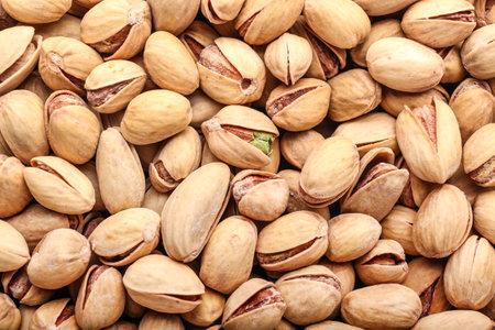 Tasty pistachio nuts as background Standard-Bild