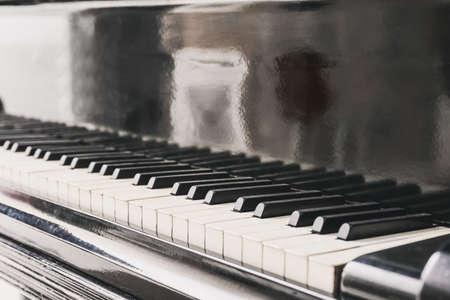 Keys of grand piano, closeup