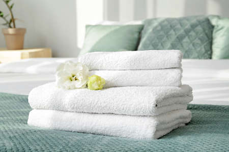 Clean soft towels on bed