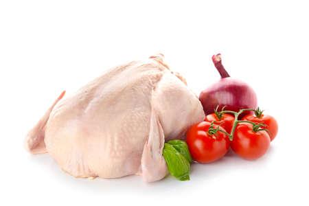 Raw chicken with vegetables on white background Reklamní fotografie