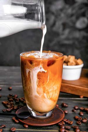 Preparing of cold coffee on dark background Standard-Bild