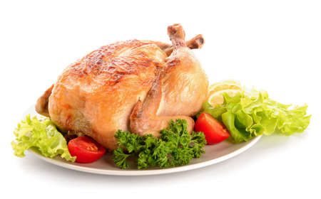 Plate with baked chicken on white background