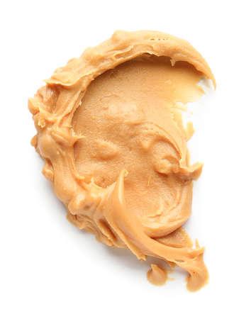 Tasty peanut butter on white background