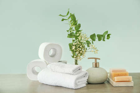 Set of bath accessories on gray table
