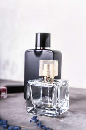 Bottles of perfumes on light background