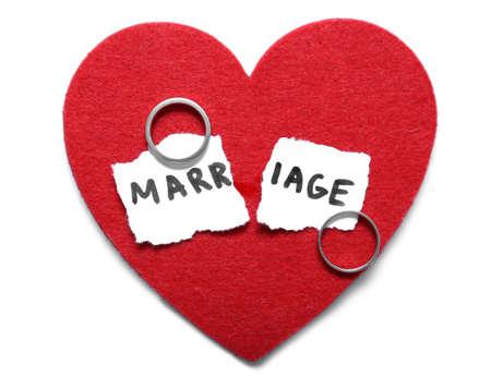 Red heart, torn paper with word MARRIAGE and rings on light background. Concept of divorce Stockfoto