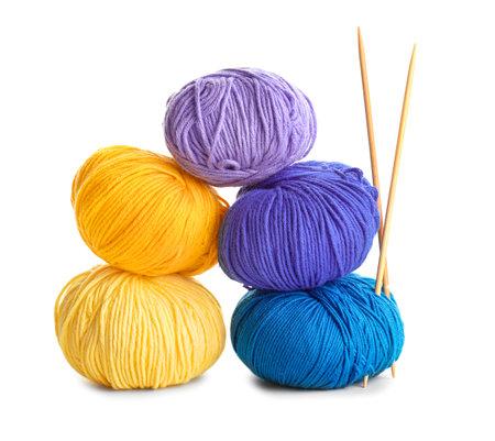 Knitting yarns and needles on white background
