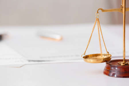Scales of justice on lawyer's workplace Stock Photo