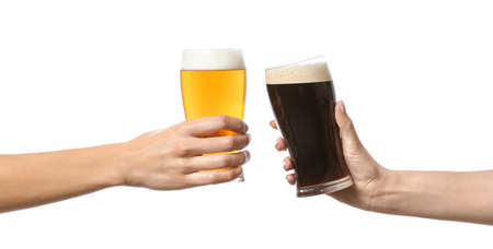 Hands clinking glasses of beer on white background