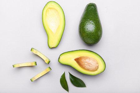 Ripe avocados on light background Stockfoto