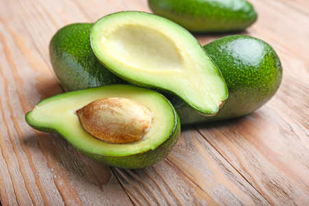 Ripe avocados on wooden background
