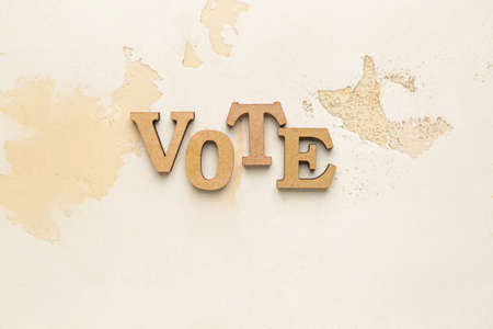 Text VOTE on light background